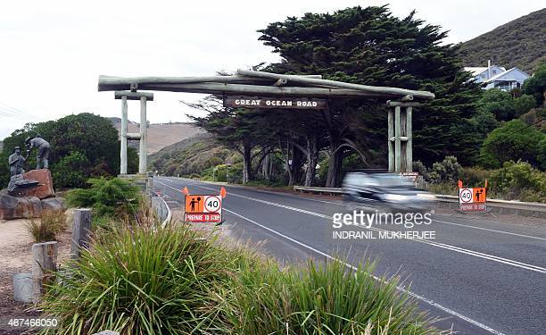 In this photo taken on March 24 a car passes beneath the Memorial Arch of the Great Ocean Road in Victoria. The 243 kilometres Australian National...
