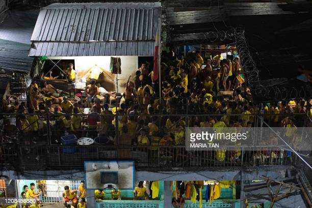 In this photo taken on March 27 prison inmates are seen at the crowded courtyard of the Quezon City jail in Manila. - UN rights chief Michelle...