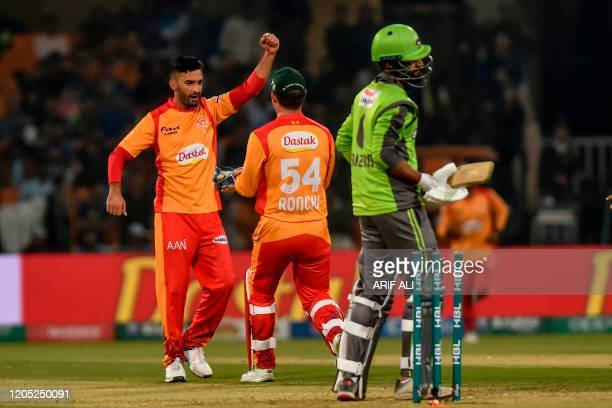 In this photo taken on March 4 Islamabad United's Zafar Gohar celebrates after taking the wicket of Lahore Qalandars's Muhammad Faizan during the...