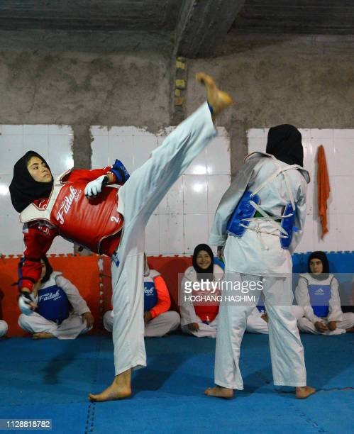 In this photo taken on March 5 2019 Afghan girls and women take part in a taekwondo training session at a gym in Injil district in Herat province