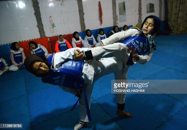 TOPSHOT In this photo taken on March 5 2019 Afghan women take part in a taekwondo training session at a gym in Injil district in Herat province