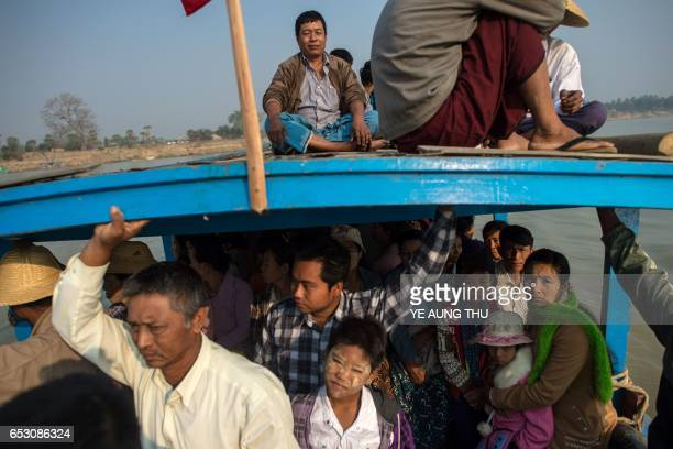 In this photo taken on March 7 people ride a ferry on the Chindwin river in central Myanmar near Pakhangyi town as they head to participate in the Ko...