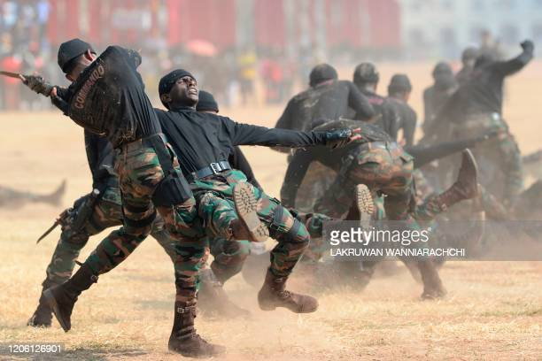 In this photo taken on March 8 Sri Lankan Commando Regiment soldiers perform during a demonstration following celebrations to mark the 40th...