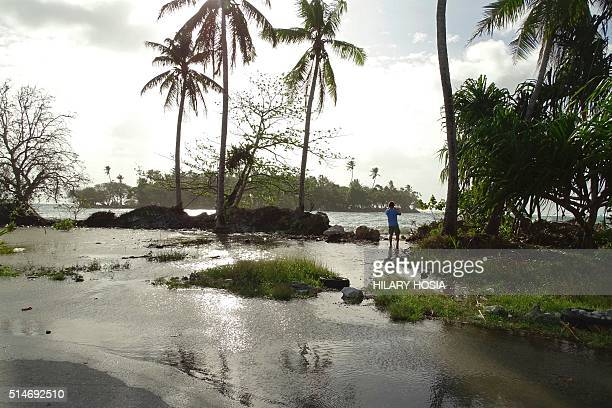 In this photo taken on March 9 a resident walks through tidal water in Majuro Atoll in the Marshall Islands Residents in lowlying areas of the...