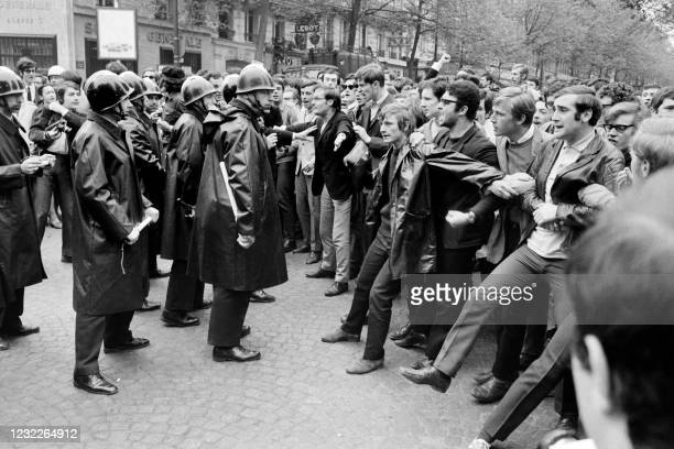 In this photo taken on May 06, 1968 protesting students face French CRS riot police charge during a demonstration near the Sorbonne University, on...