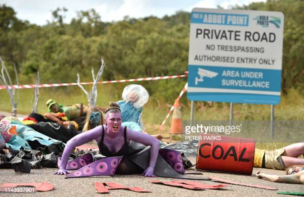 In this photo taken on May 1 2019 shows environmental campaigners holding a protest against the development of the Indiabacked Adani coal mine at the...