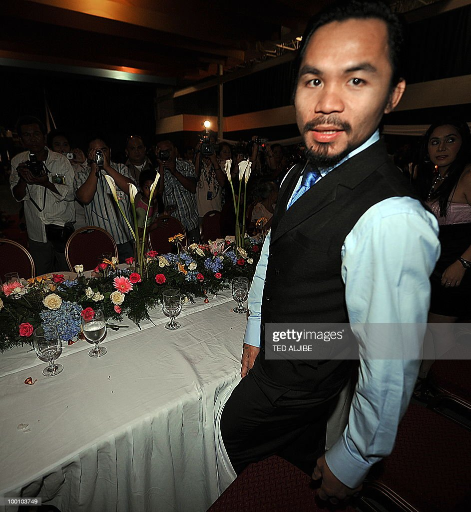 In this photo taken on May 15, 2010 shows Philippines boxing supertar Manny Pacquiao preparing to sit during his victory party at the convention center in General Santos City, in the southern island of Mindanao, after winning a seat in the parliament. World boxing champion Manny Pacquiao is returning to school for a crash course to prepare for his new job as a Philippine legislator, he said in an interview aired May 20. The 31-year-old fighter, who was elected on May 10 as representative of the southern province of Sarangani, said he would be taking a week-long course at the state university before he assumes his position on June 30.