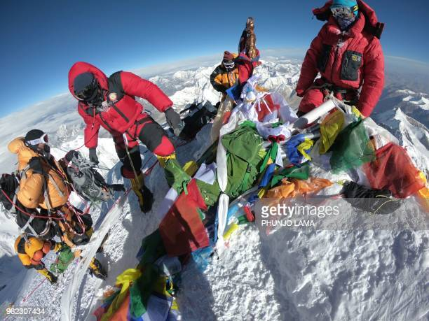 In this photo taken on May 17 mountaineers and sherpas gather at the summit of Mount Everest after ascending on the south face from Nepal