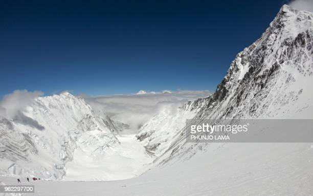 In this photo taken on May 17 mountaineers make their way to the summit of Mount Everest as they ascend on the south face from Nepal