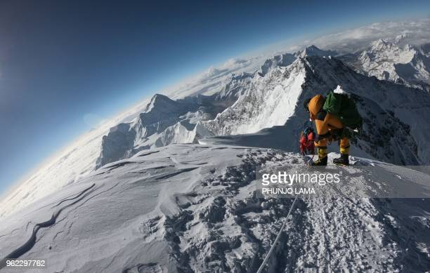 In this photo taken on May 17 mountaineers make their way to the summit of Mount Everest, as they ascend on the south face from Nepal.