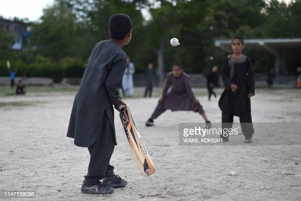 TOPSHOT In this photo taken on May 19 Afghan children play cricket in a field in Kabul Afghanistan caught the cricket bug thanks largely to a new...