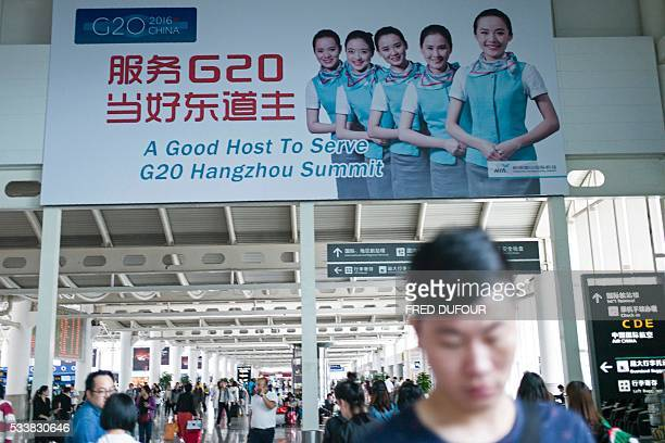 In this photo taken on May 21 a billboard for the upcoming G20 Hangzhou Summit scheduled to be held this September 45 is seen at the airport in...