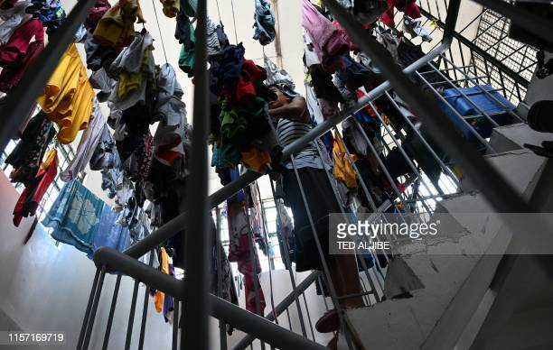 In this photo taken on May 21 a minor being held at a juvenile detention centre collects his laundry in Malolos town, Bulacan province, north of...