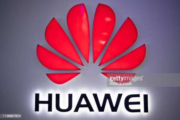 In this photo taken on May 27 a Huawei logo is displayed at a retail store in Beijing China is digging in for a tough period of deteriorating ties...