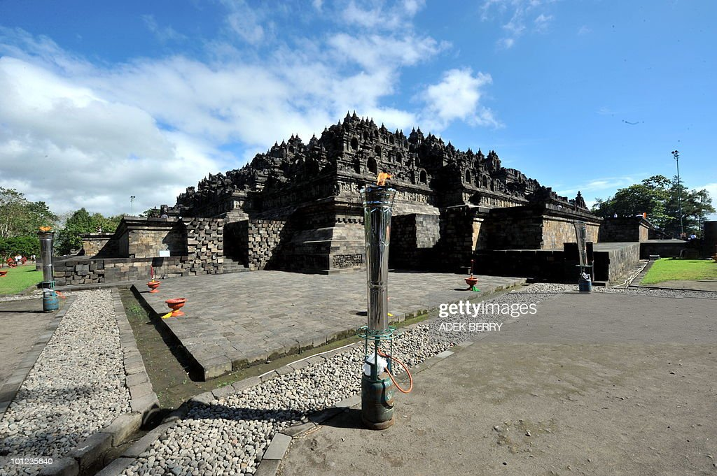 In this photo taken on May 28, 2010 in Magelang shows the Borobudur temple as both a shrine to the Lord Buddha and place for Buddhist pilgrimage. The Borobudur is a ninth-Century Mahayana Buddhist monument located at Magelang, 42-km northwest of Yogyakarta. The Borobudur temple is the one of the best-preserved ancient monument in Indonesia that are most frequently visited by over a million domestic as well as foreign visitors. Borobudur temple built in the eighth century by the Cailendra dynasty.