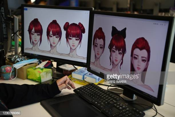 In this photo taken on November 12 an animator works on hairstyles for a virtual idol at the Beijing Mizhi Tech offices in Beijing. - Although the...