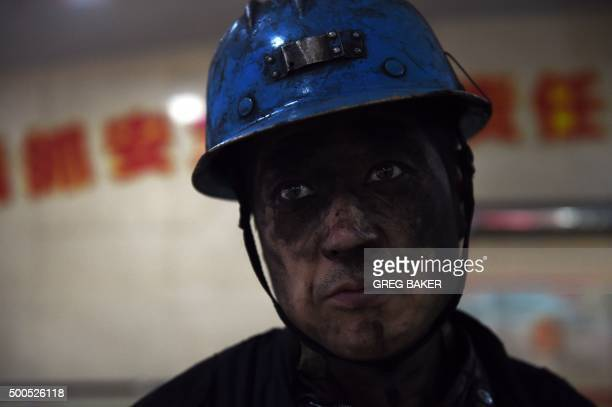 In this photo taken on November 19 a miner is seen after his shift at the Tashan coal mine in Datong in China's northern Shanxi province For decades...