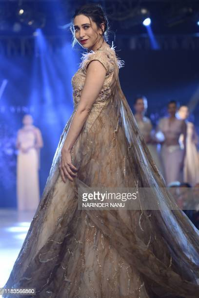 In this photo taken on November 19 Bollywood actress Karisma Kapoorwalks on a ramp during a fashion show at a hotel on the outskirts of Amritsar