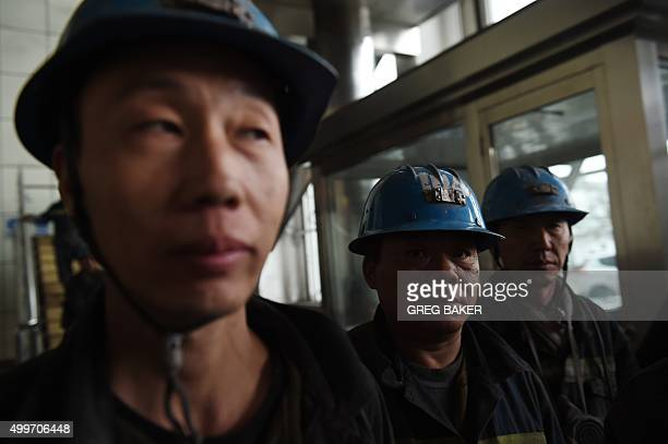 In this photo taken on November 19 coal miners wait to enter a mine at Datong in China's northern Shanxi province A Chinese pledge to upgrade the...