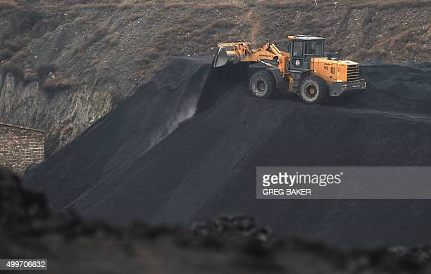 In this photo taken on November 20 a front end loader drops a load of coal near a coal mine at Datong in China's northern Shanxi province A Chinese...