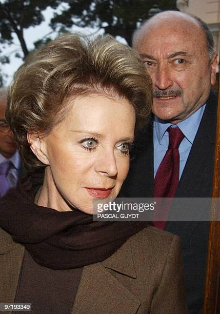 In this photo taken on November 22 2010 Lily Safra widow of billionaire Edmond Safra arrives accompanied by her lawyer Georges Kiejman at the court...