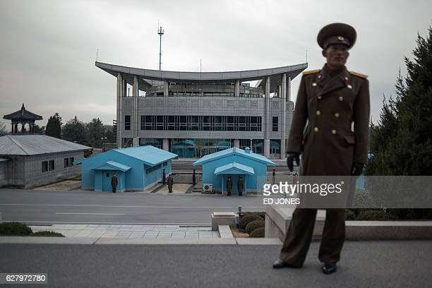 In this photo taken on November 30 a Korean People's Army soldier stands before the joint security area and Demilitarized Zone separating North and...