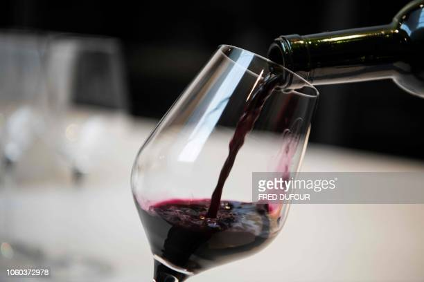 In this photo taken on October 10 a sommelier pours a glass of Ao Yun wine at the Ao Yun vineyards located beneath the Meili mountain in Adong in...