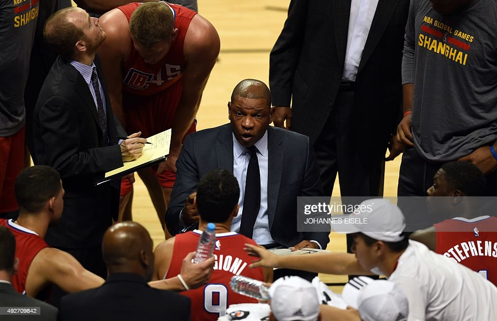 In this photo taken on October 14, 2015, Doc Rivers (C), head coach of the Los Angeles Clippers, talks to his team during the 2015 NBA Global Games China pre-season basketball match between the Charlotte Hornets and Los Angeles Clippers in Shanghai.