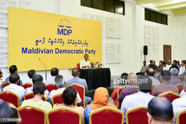 In this photo taken on October 17 former Maldives president Mohamed Nasheed the current legislative speaker and majority leader meets with members of...