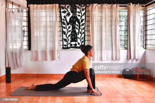 In this photo taken on October 28 breakdancer Johanna Rodrigues does yoga at her residence in Bangalore Long before bgirl Johanna Rodrigues began...