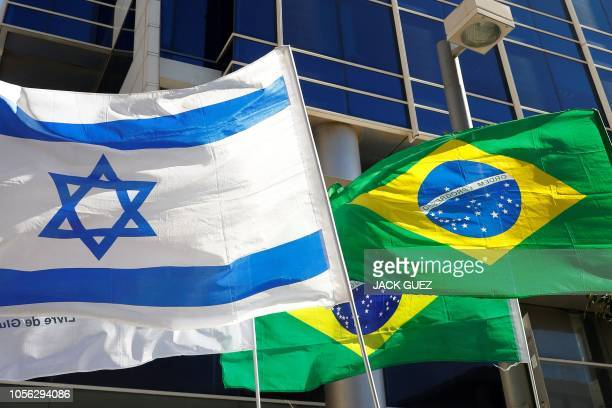 TOPSHOT In this photo taken on October 28 the Israeli and Brazilian flags hang outside the building housing the offices of the Brazilian Embassy in...