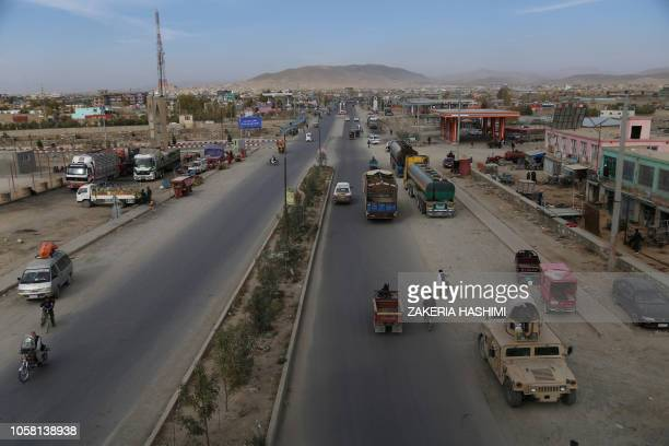 In this photo taken on October 29 Afghan local vehicles with passengers travel on the highway between Ghazni and Kabul On a good day it takes...