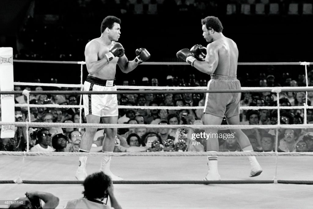 In this photo taken on October 30, 1974 shows the fight between US boxing heavyweight champions, Muhammad Ali (L) (born Cassius Clay) and George Foreman in Kinshasa. On October 30, 1974 Muhammad Ali knocked out George Foreman in a clash of titans known as the 'Rumble in the Jungle', watched by 60 000 people in the stadium in Kinshasa and millions elsewhere.