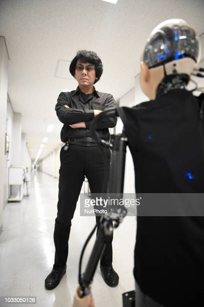 In this photo taken on September 13 2018 shows Robot engineer Hiroshi Ishiguro and his 10 year old child android robot called ampquotIbukiampquot...