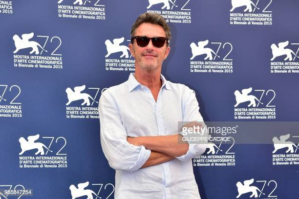 In this photo taken on September 2 2015 member of the jury 'Venezia 72' Polish director Pawel Pawlikowski poses during a photocall on the opening day...