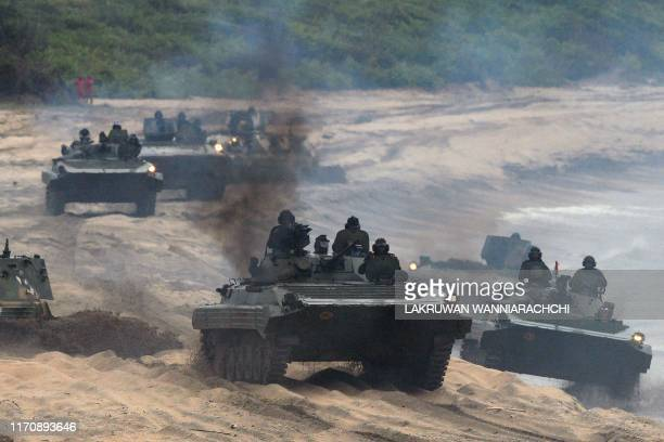 In this photo taken on September 23 2019 shows Sri Lankan military personnel in tanks taking part in a training exercise on the eastern coast of...