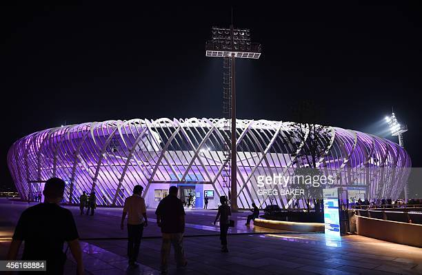 In this photo taken on September 26 2014 spectators walk outside the center court stadium at the Optics Valley International Tennis Centers the venue...