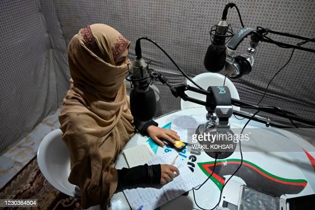 In this photo taken on September 29 disc jockey Habiba Quraishi speaks during a broadcast at the Merman radio station in Kandahar. - Once the...