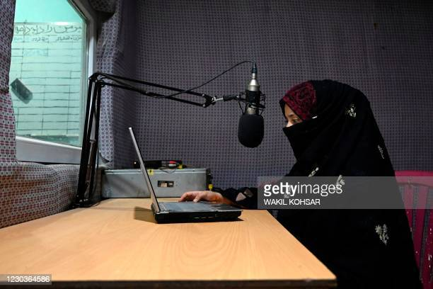 In this photo taken on September 29 radio presenter Shukria Wali reads the news during a broadcast at the Merman radio station in Kandahar. - Once...