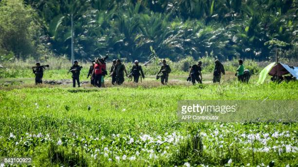 In this photo taken on September 5, 2017 shows Moro Islamic Liberation Front rebels from the 118th base command patrolling an area once held by ISIS...
