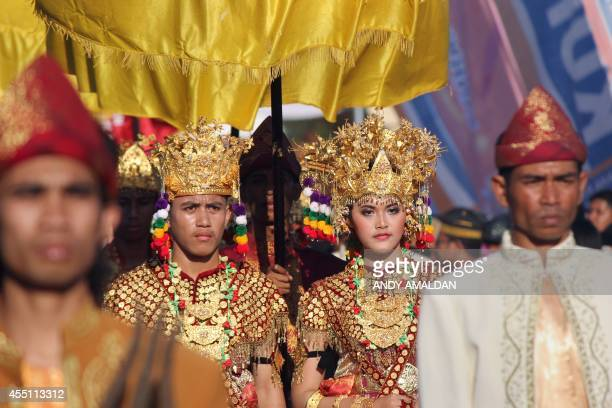 In this photo taken on September 7 the prince and princess from the Sultanate of Palembang Darussalam parade during a royal festival locally called...