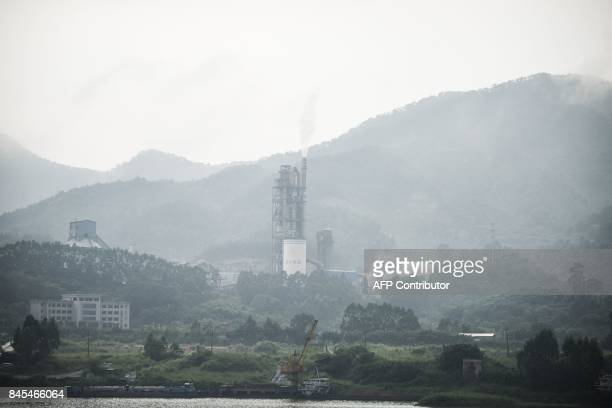 In this photo taken on September 9 a factory is seen in Datangzhen Guangdong province / AFP PHOTO / FRED DUFOUR