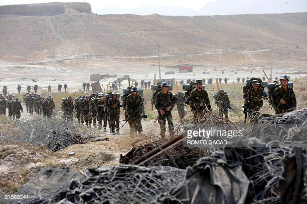In this photo taken September 27 shows Afghan soldiers armed with US made M16 rifles marching as they take part in combat training at The Afghan...