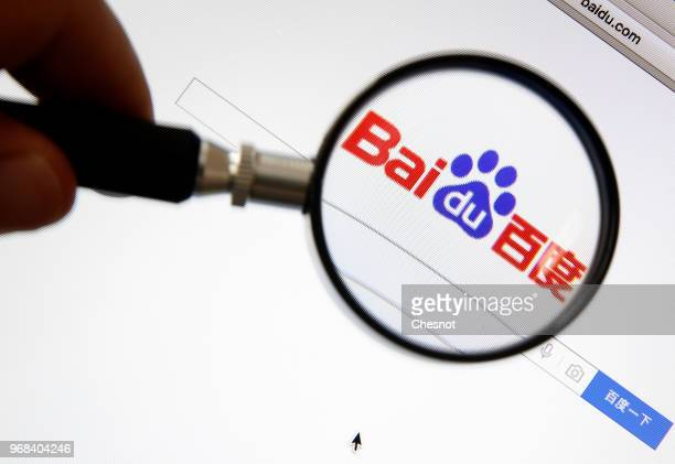 In this photo, the logo Baidu is seen through a magnifying glass on the screen of a computer screen on June 06, 2018 in Paris, France. Baidu is the...