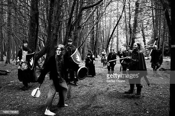 In this photograph a group of townsfolk descend on a disciple after it was discovered that the ritual he participated in left a person dead during an...