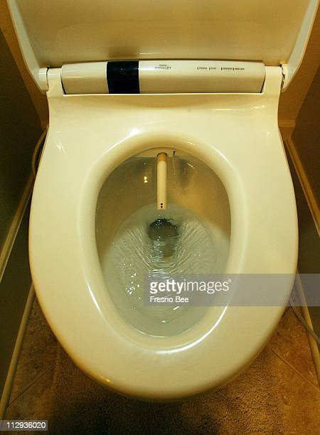 In this photograph, a Toto Washlet, a kind of bidet/toilet, is pictured at the home of Ray Weitzman in Fresno, California. This kind of toilet is big...