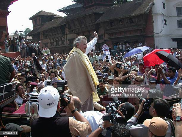 In this photograph dated 27 May 2003 New Zealand mountaineer Sir Edmund Hillary waves as he arrives for an official ceremony as part of the Mount...