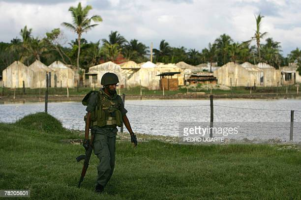 SMITH 'SRI LANKAUNRESTMEDIACENSORSHIPRIGHTS' In this photograph dated 28 November 2007 aSri Lankan soldier walks in front of destroyed houses along...
