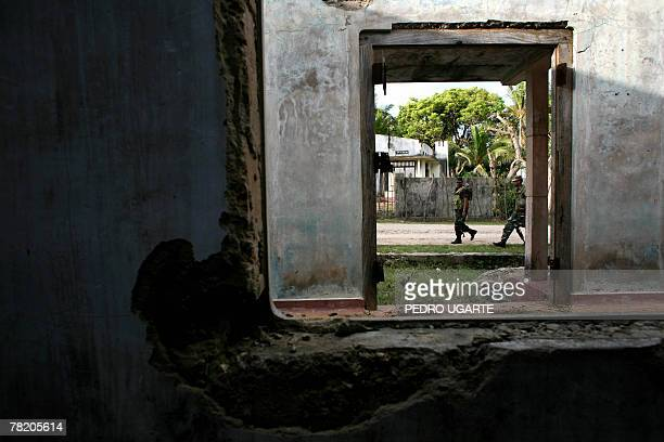 SMITH 'SRI LANKAUNRESTMEDIACENSORSHIPRIGHTS' In this photograph dated 28 November 2007 Sri Lankan soldiers patrol next to destroyed houses along the...