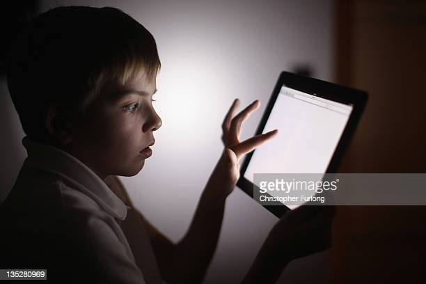 In this photograph illustration a tenyearold boy uses an Apple Ipad tablet computer on November 29 2011 in Knutsford United Kingdom Tablet computers...